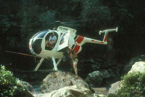 Hughes 500 in creekbed